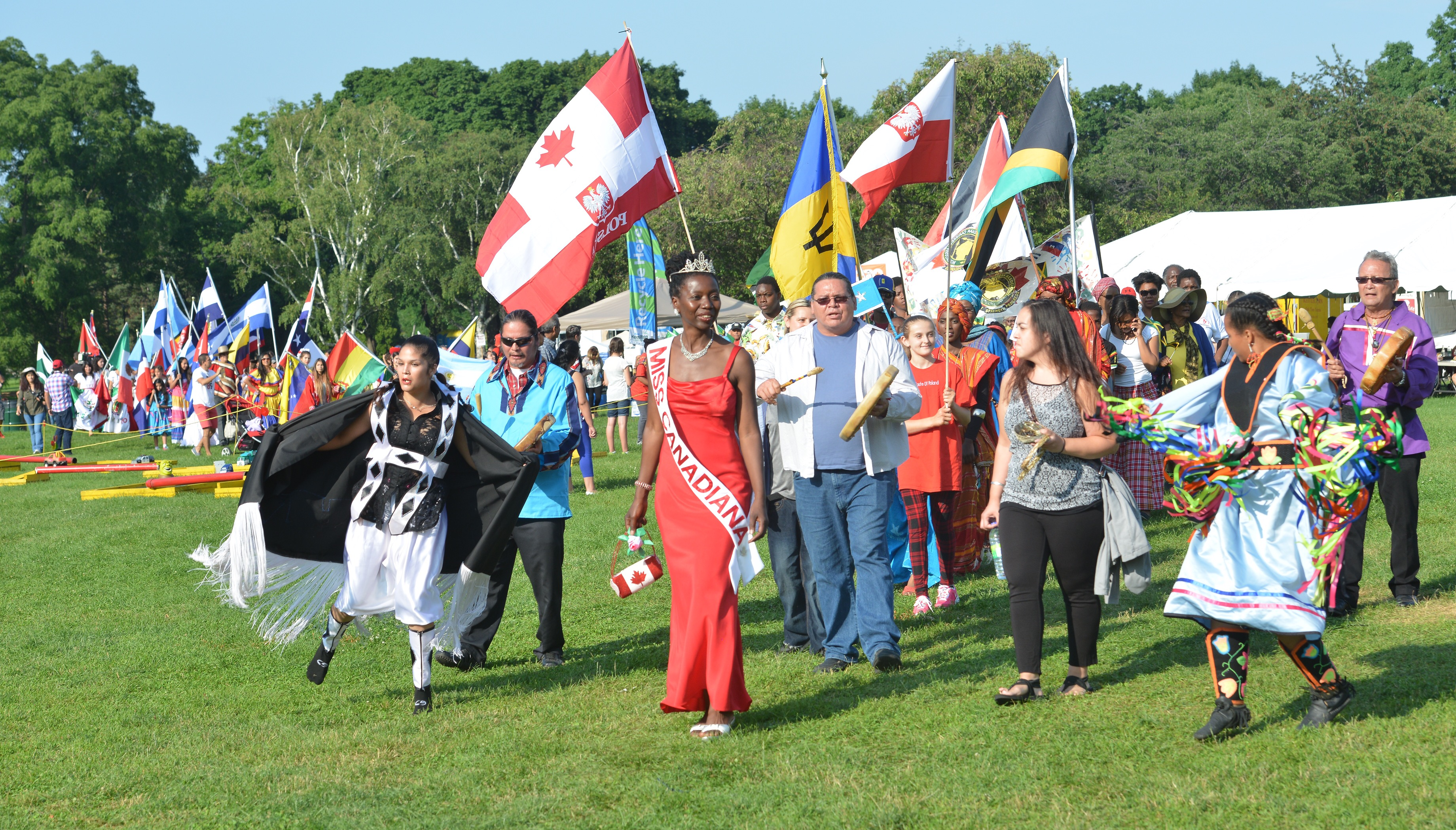 On 2015-07-09,at 6:18 PM Novak, Kaz (KNovak@thespec.com) Subject: Cultural Parade      Hamilton  , Ontario, July 9, 2015  Miss Canadiana Camille Turner  leads the Cultural  Parade as Its  Your Festival  kicks off at Gage Park Photo  by Kaz Novak, The Hamilton Spectator      Sent from my iPhone